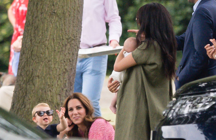 Meghan Markle holds Archie with Kate Middleton and Prince Louis nearby.