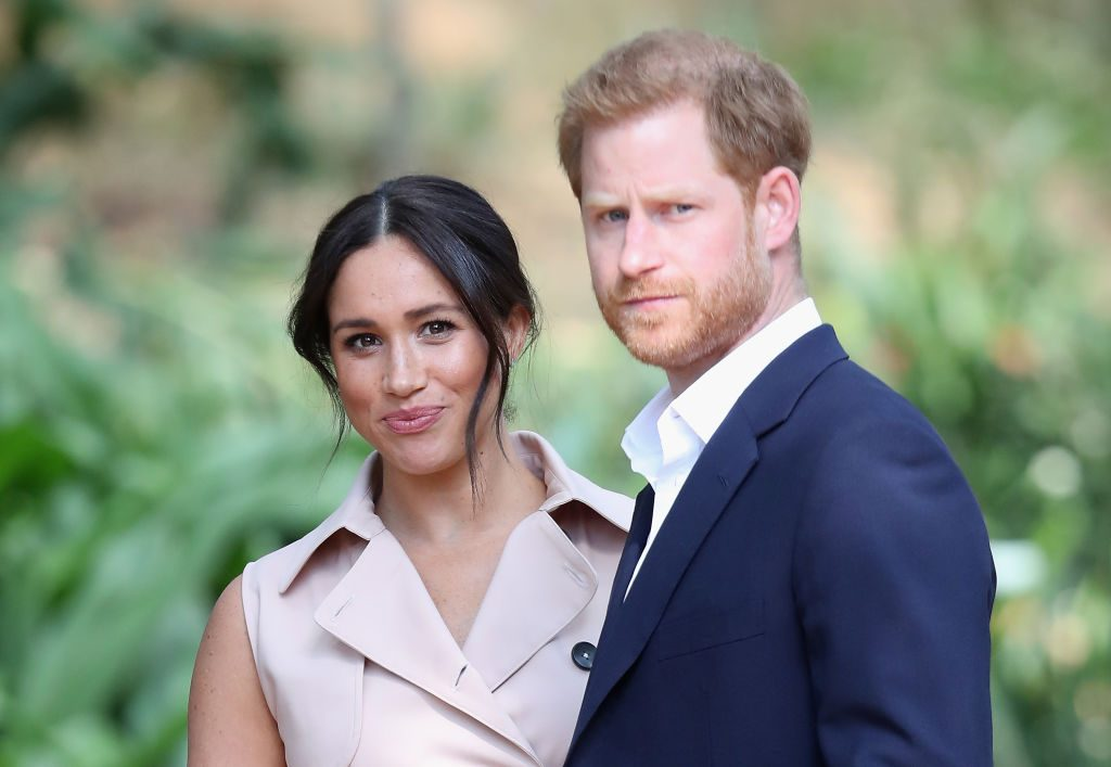 (L) Meghan Markle and (R) Prince Harry during a visit to Johannesburg