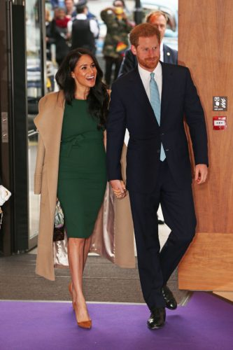 Meghan Markle and Prince Harry holding hands as they attend WellChild Awards, Oct. 2019.