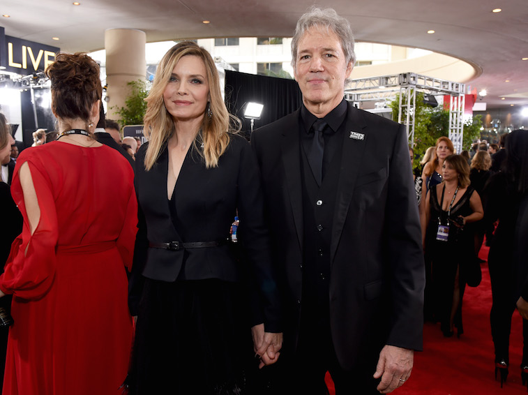 David E. Kelley and Michelle Pfeiffer holding hands at the Golden Globes