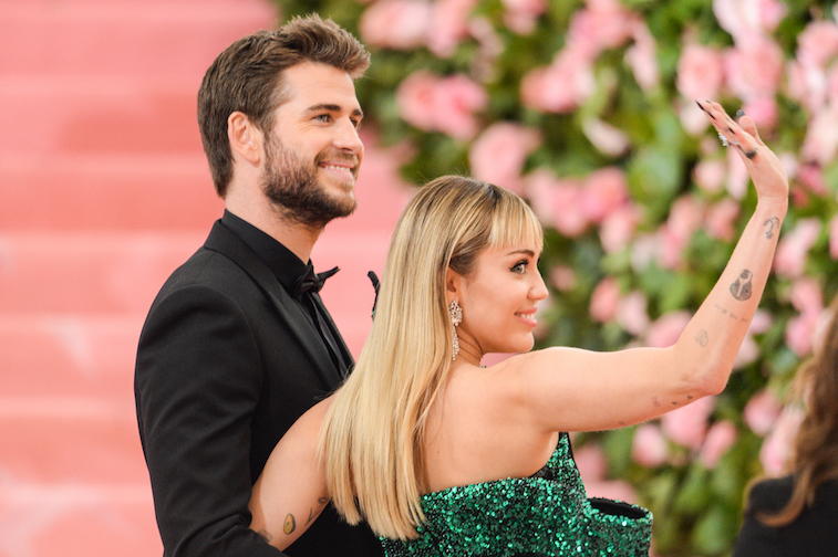 Liam Hemsworth and Miley Cyrus arrive at the Met Gala