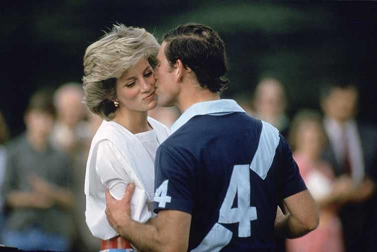 Prince Charles kissing Princess Diana