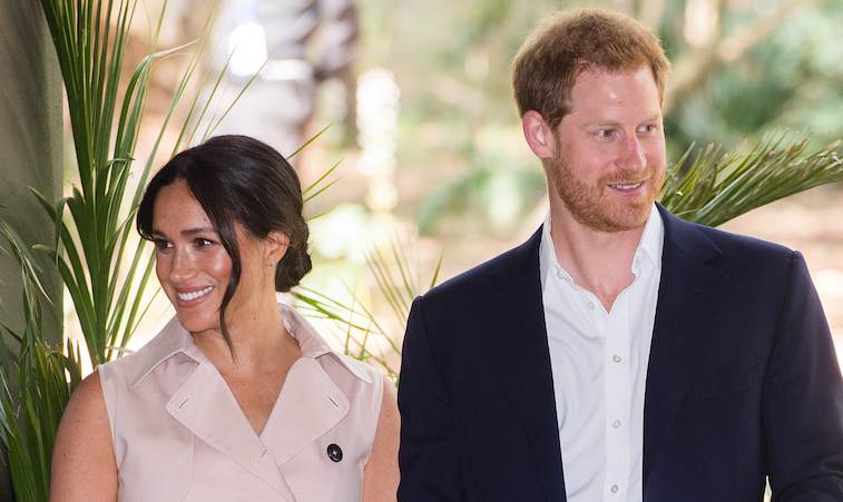 Prince Harry and Meghan Markle posing for the camera