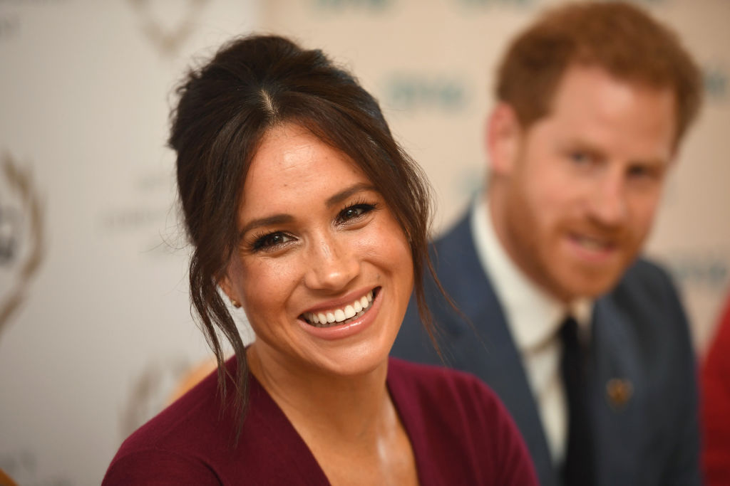 Prince Harry and Meghan Markle posing formally for the camera