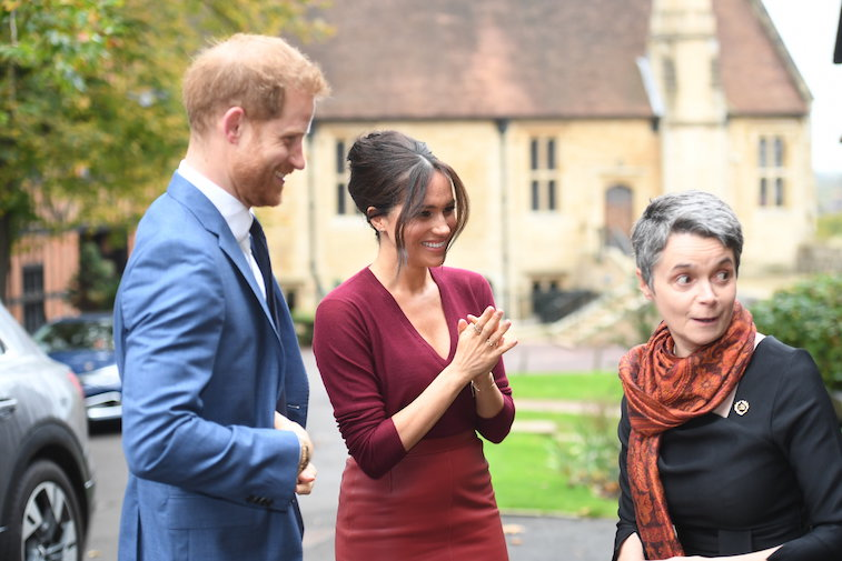 Prince Harry and Meghan Markle attain at an occasion