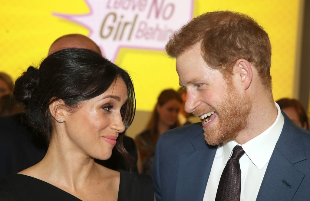 Prince Harry (R) and Meghan Markle, attend a reception for Women's Empowerment at the Royal Aeronautical Society i