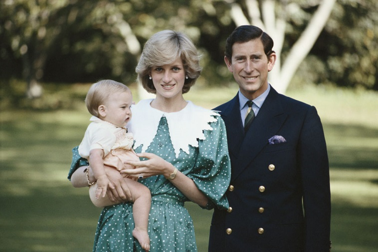 Princess Diana holding Prince William with Prince Charles