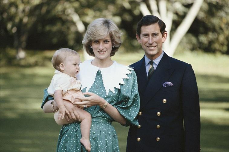 Princess Diana holding Prince William with Prince Charles