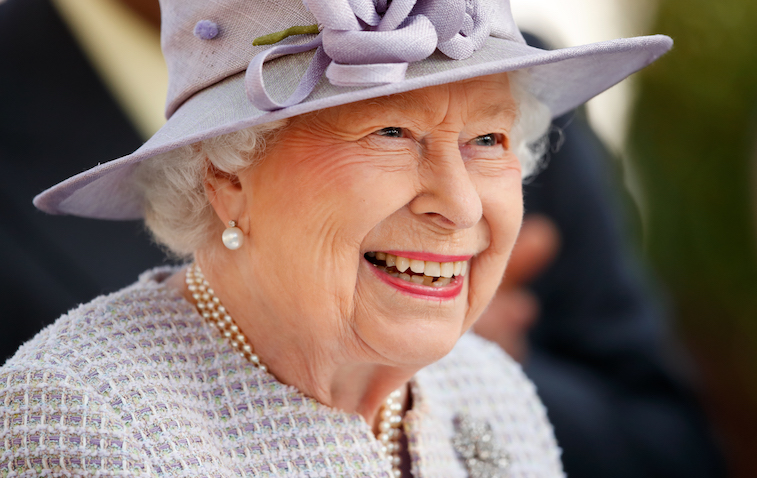 Queen Elizabeth II smiling for the camera
