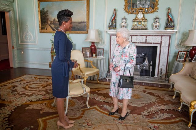 Queen Elizabeth II and Lakisha Grant, High Commissioner for Grenada.