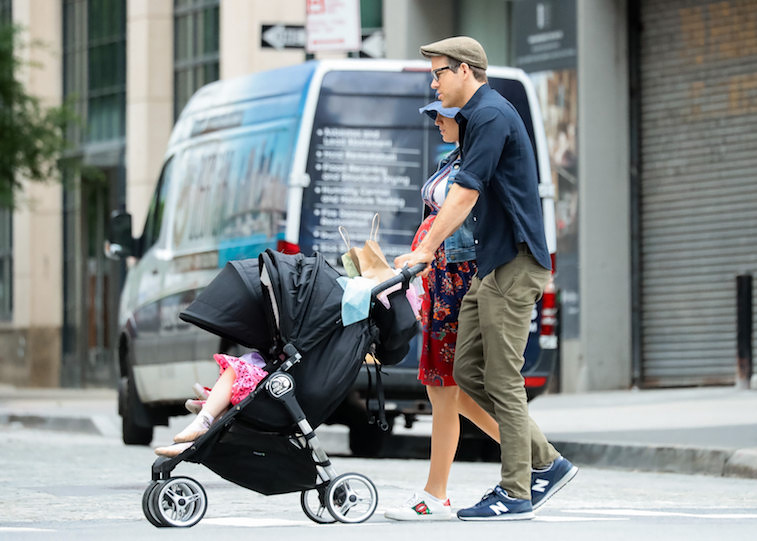 Ryan Reynolds walking with his wife and kids