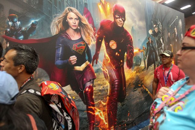 A mural featuring Supergirl and The Flash at San Diego Comic-Con