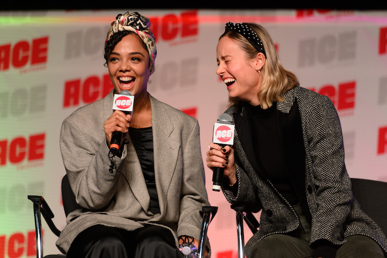 Tessa Thompson and Brie Larson speaking onstage