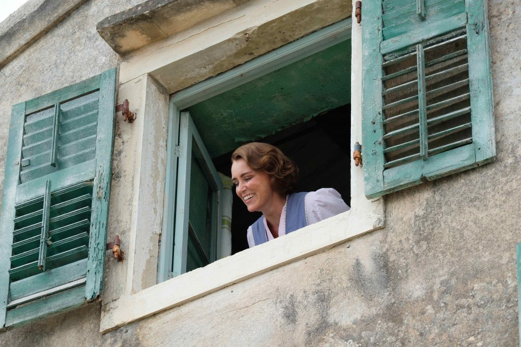Louisa Durrell looking out window