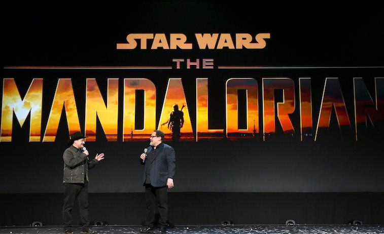 Dave Filoni and Jon Favreau talking onstage about The Mandalorian