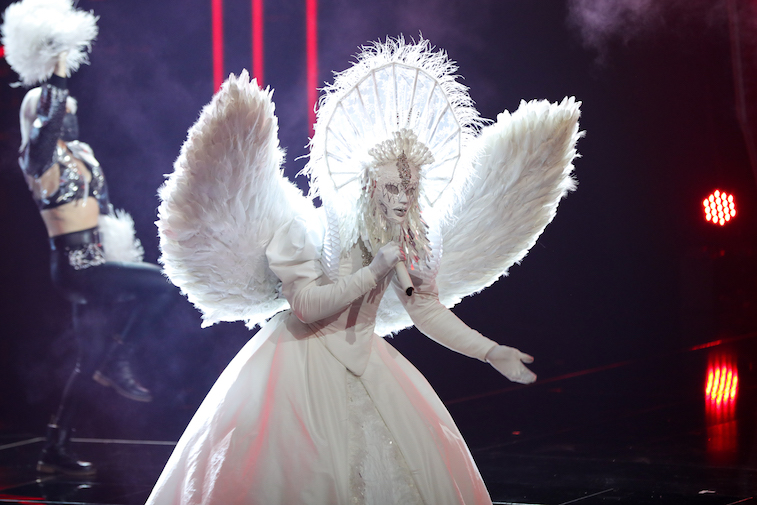A singer performs onstage during the competition