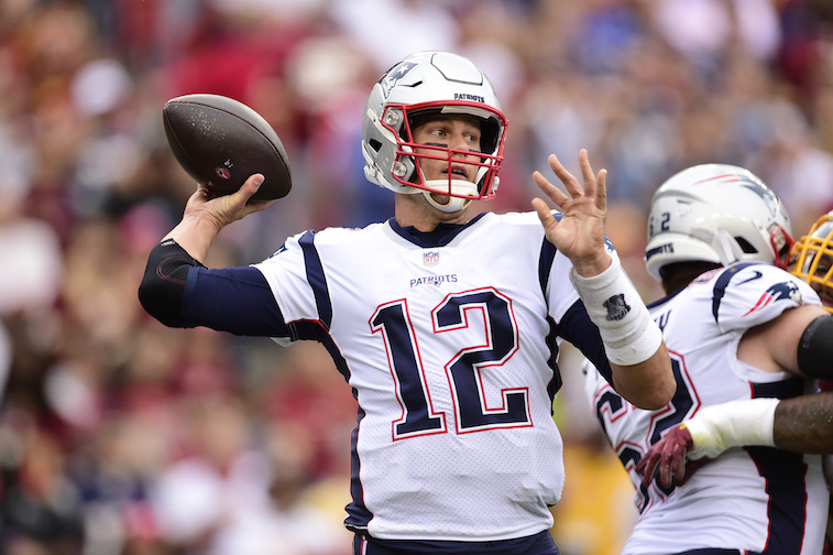 Tom Brady playing football