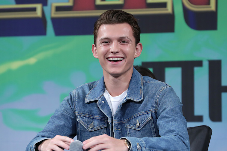 Tom Holland onstage at a press conference