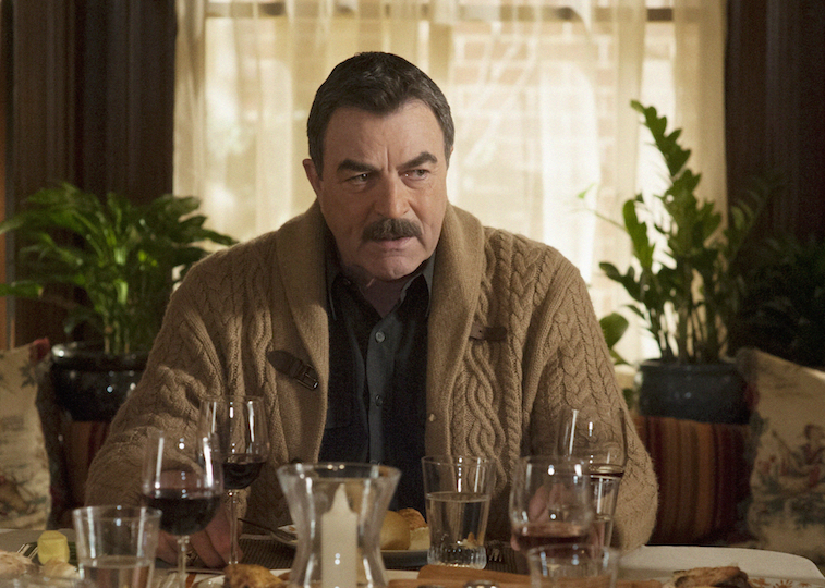 Tom Selleck as Frank on Blue Bloods sitting at the dinner table