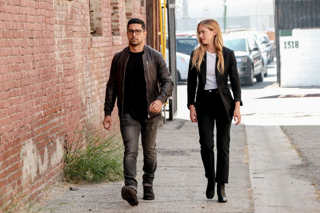 Wilmer Valderrama and Emily Wickersham during a scene in NCIS | Eddy Chen/CBS via Getty Images