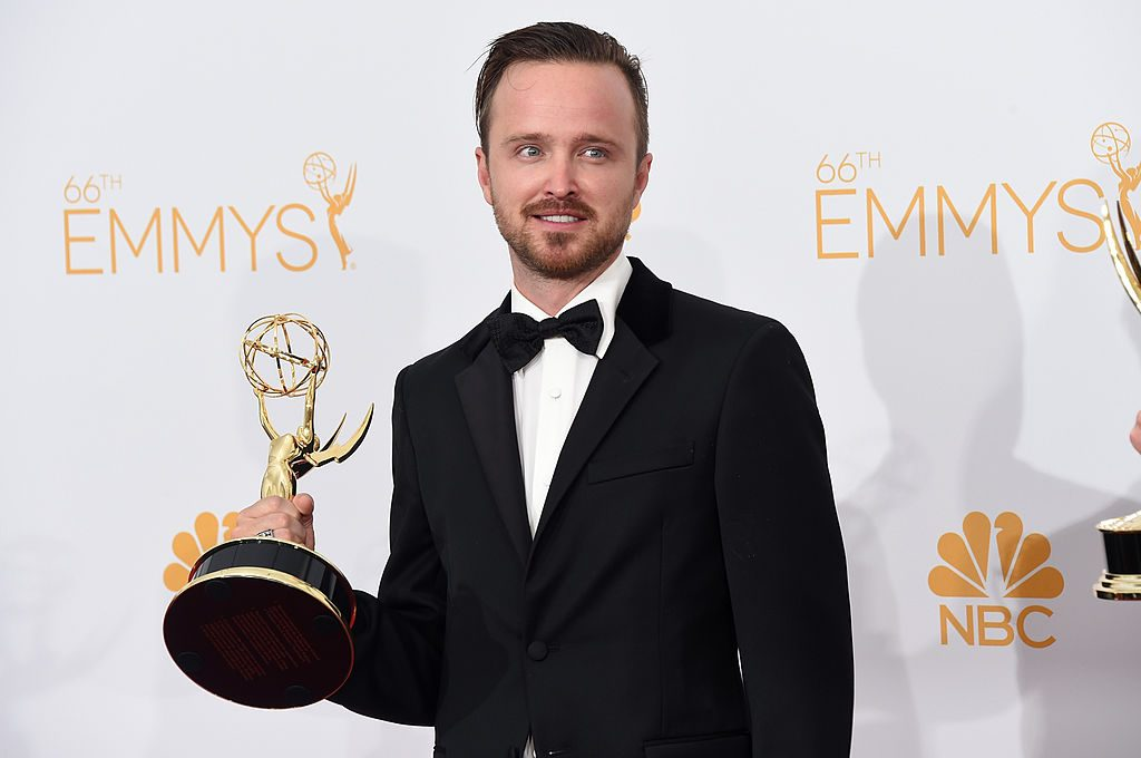 """Aaron Paul, winner of Outstanding Drama Series Award and Outstanding Supporting Actor in a Drama Series Award for """"Breaking Bad"""" poses in the press room during the 66th Annual Primetime Emmy Awards."""