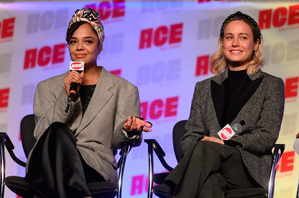 Tessa Thompson and Brie Larson attend ACE Comic Con Midwest on October 12, 2019