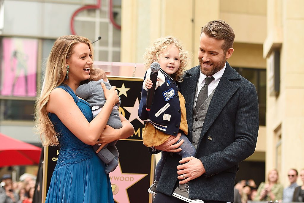 Blake Lively and Ryan Reynolds pose with their daughters on the Hollywood Walk of Fame on December 15, 2016