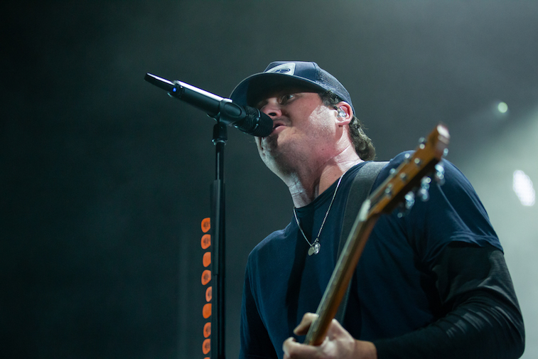 Tom DeLong performs onstage