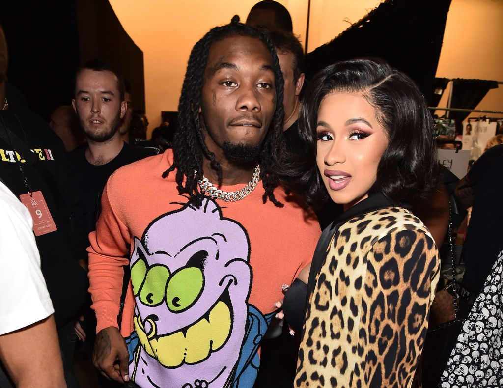 Offset and Cardi B pose backstage at the Jeremy Scott show during New York Fashion Week