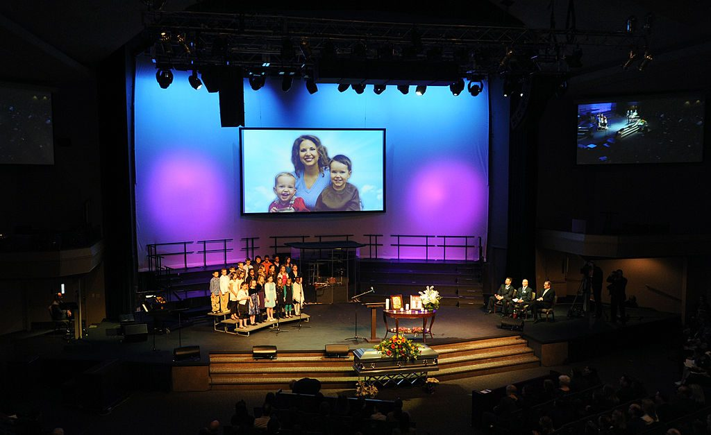 Image of Susan Powell and her children on a large screen