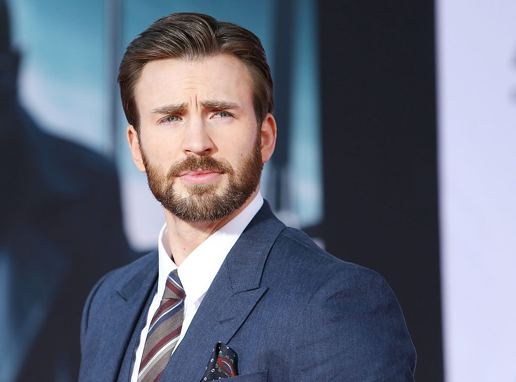 """Chris Evans arrives at the Los Angeles premiere of """"Captain America: The Winter Soldier"""" held at the El Capitan Theatre."""