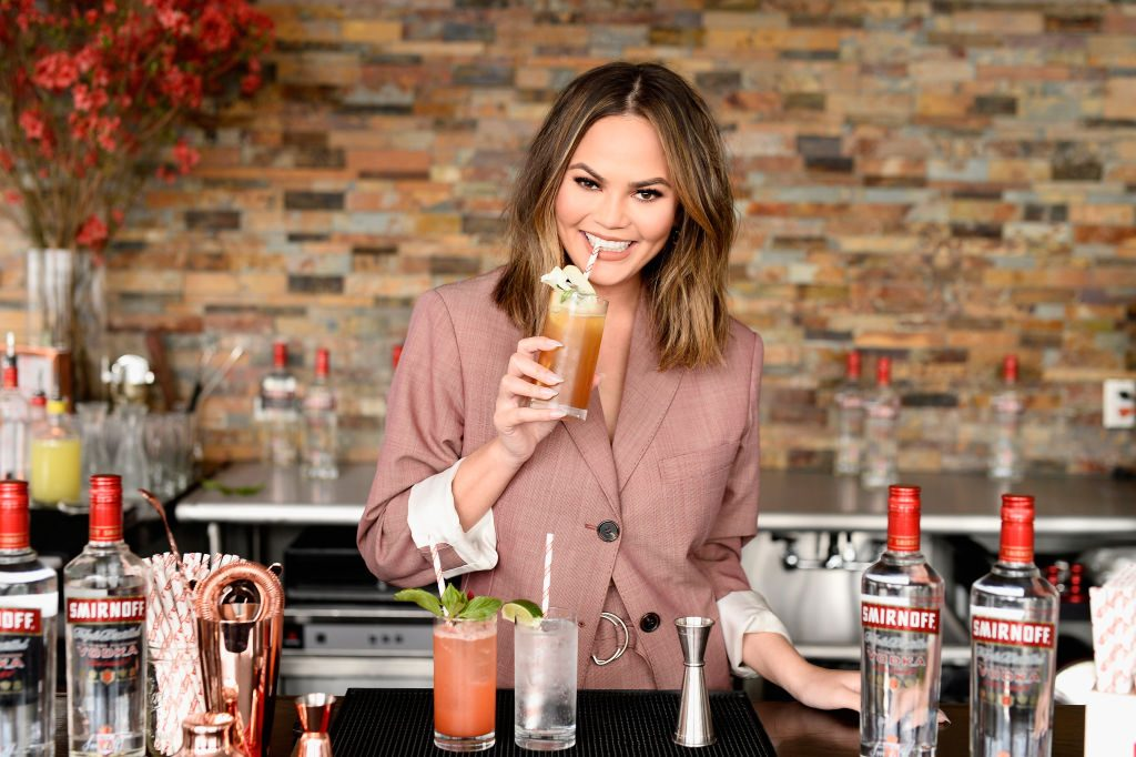"Chrissy Teigen hosts a ""Cocktails with Chrissy"" event featuring delicious Smirnoff No. 21 Vodka summer cocktails on April 27, 2017 in New York City."