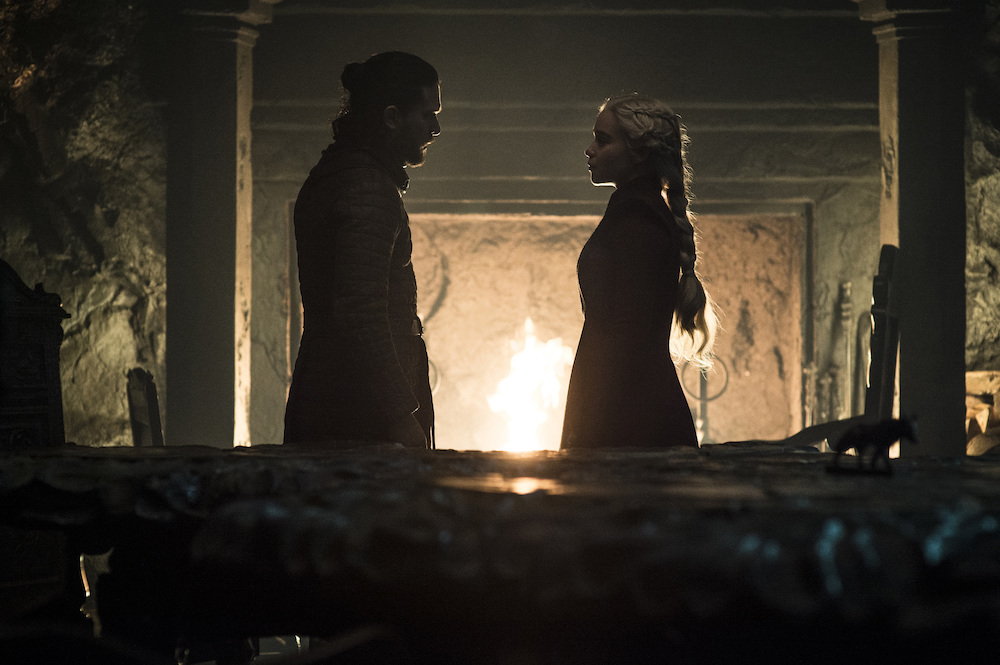 """Daenerys and Jon talk in front of a fireplace (Episode 5, 'Game of Thrones"""")."""