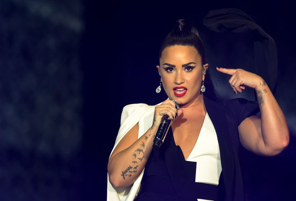Demi Lovato wearing a black and white outfit