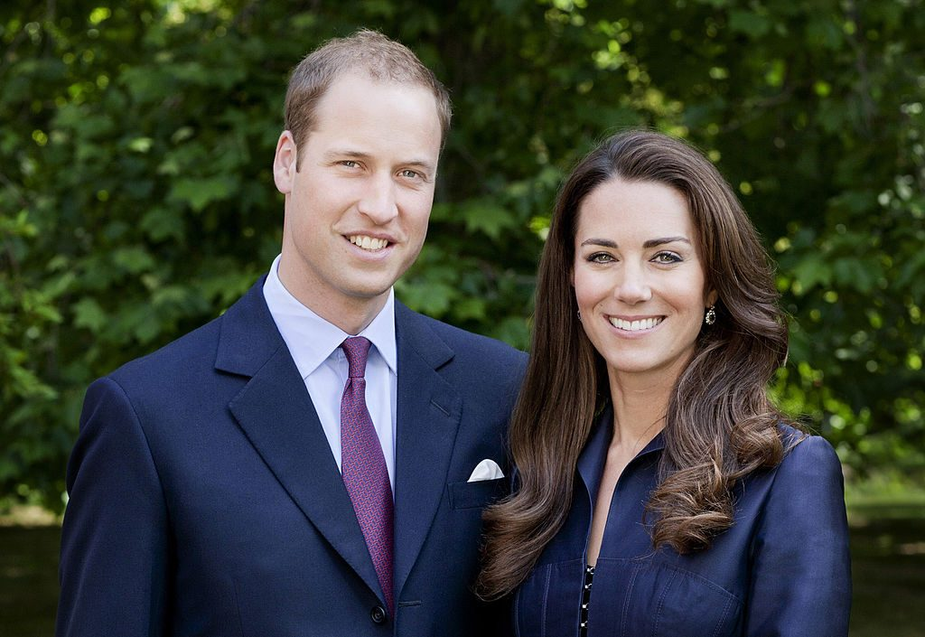 Prince William and Kate Middleton pose for the official tour portrait for their trip to Canada and California in the Garden's of Clarence House.