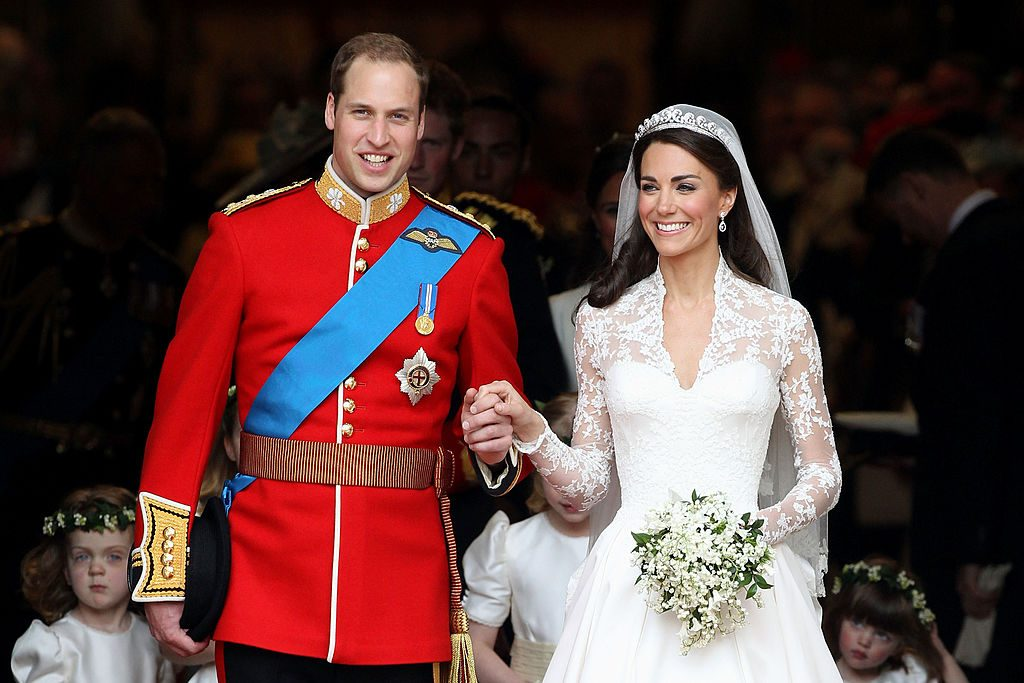 Prince William and Kate Middleton smile following their marriage at Westminster Abbey.