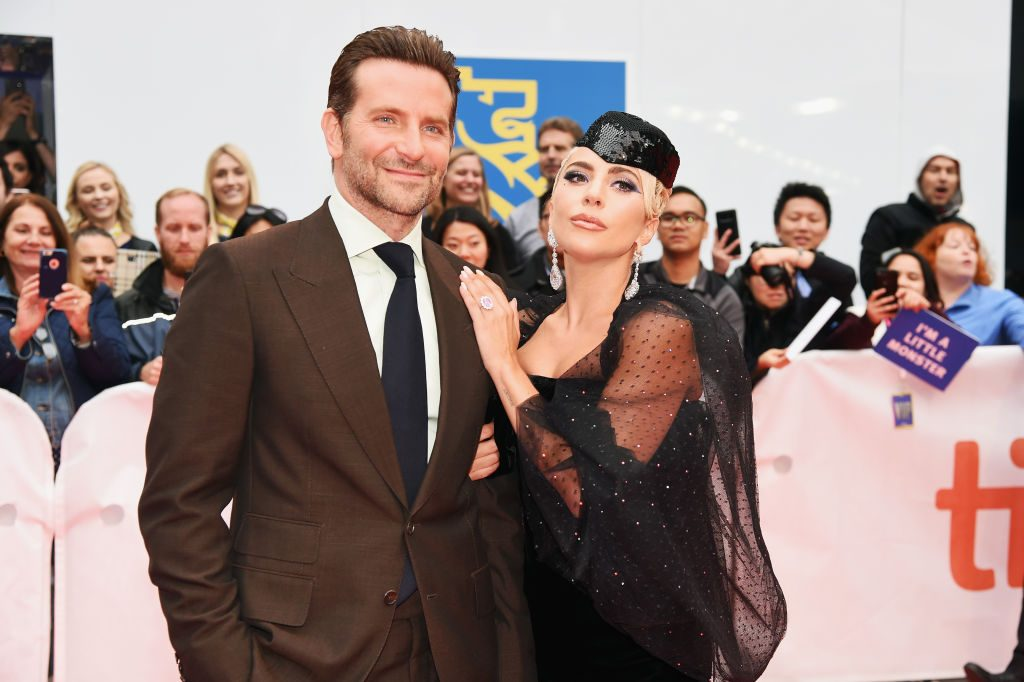 This image has an empty alt attribute; its file name is lady-gaga-touching-Bradley-Cooper-suit-1024x682.jpg