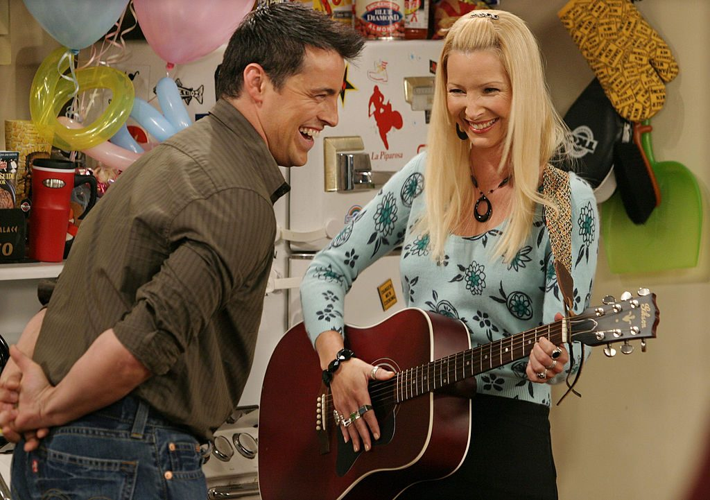 """Matt LeBlanc and Lisa Kudrow crack each other up on the set of the hit NBC series """"Friends."""""""
