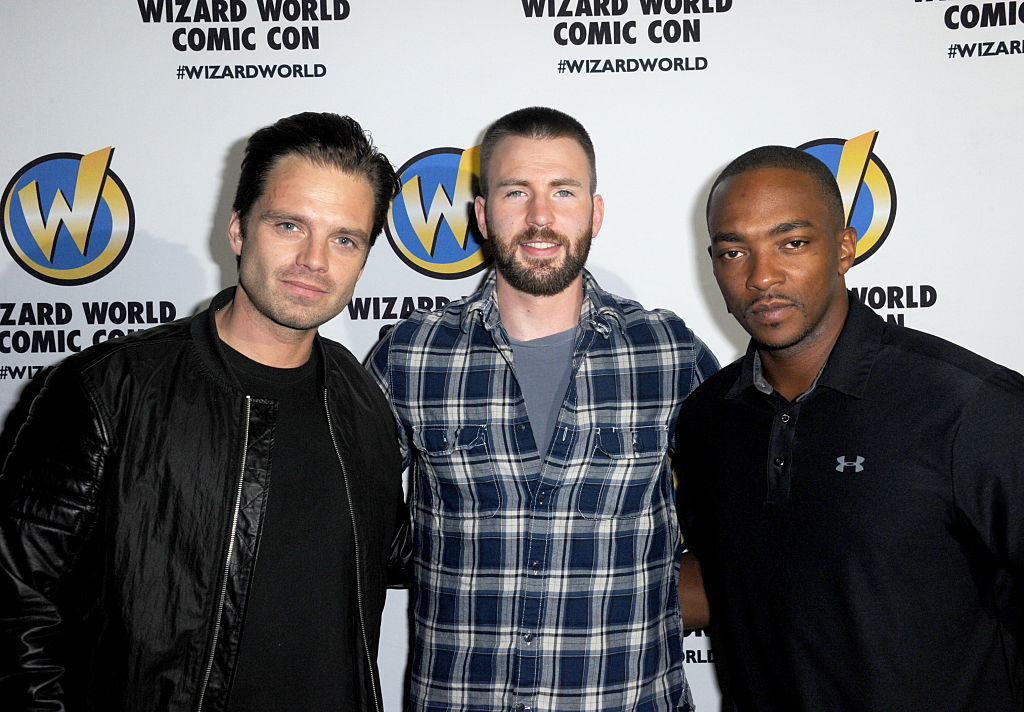 Sebastian Stan, Chris Evans, and Anthony Macki at a comic convention.