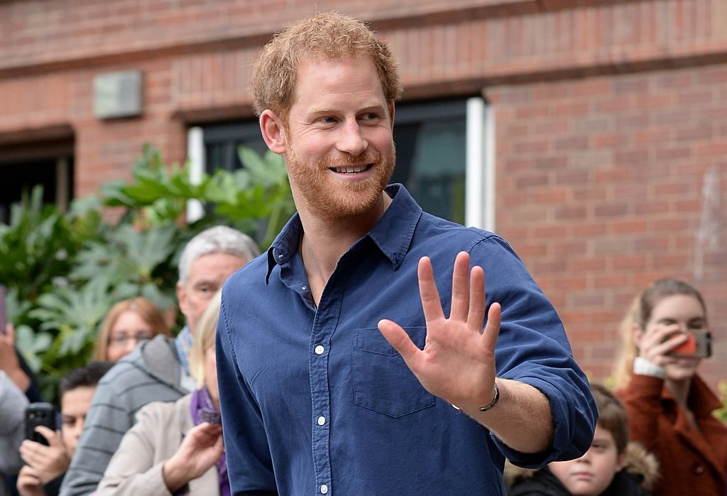 Prince Harry waves as he leaves Nottingham's new Central Police Station.