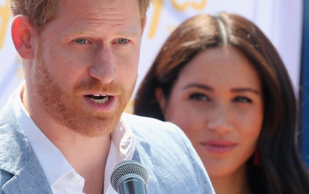 Prince Harry and Meghan Markle during a visit a township to learn about Youth Employment Services in Johannesburg, South Africa.