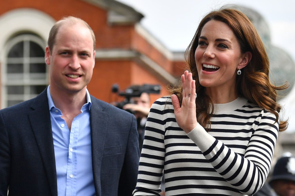 Prince William and Kate Middleton wave to well wishers as they leave after attending the launch of the King's Cup Regatta at Cutty Sark.
