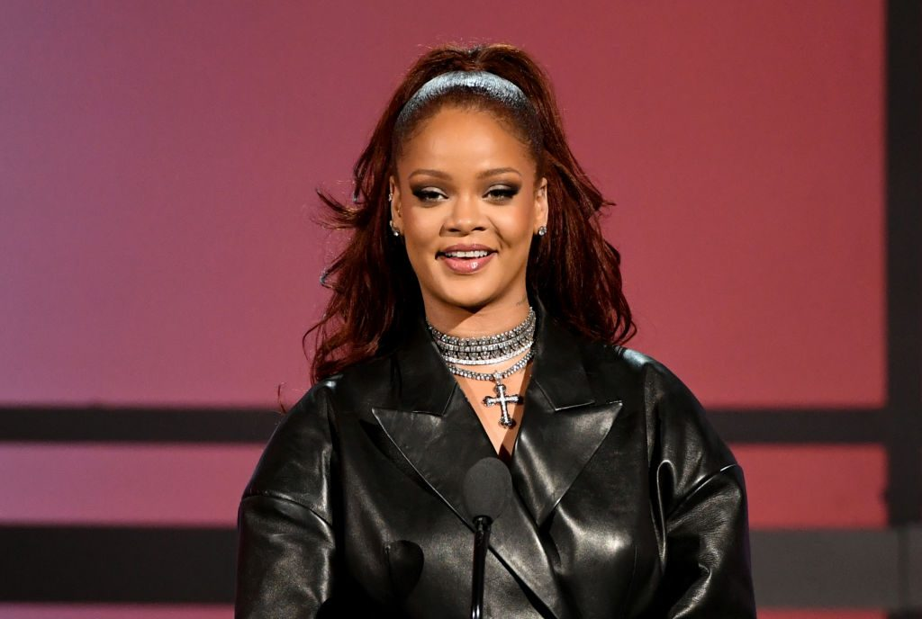 Rihanna speaks onstage at the 2019 BET Awards.