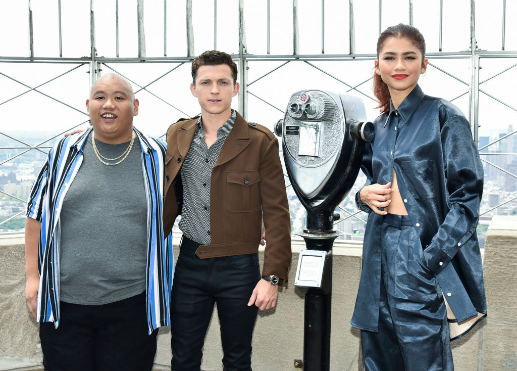 Jacob Batalon, Tom Holland, and Zendaya attend an event at the Empire State Building.