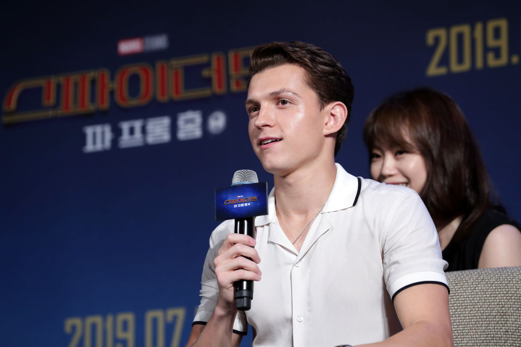 Tom Holland speaking on a panel.