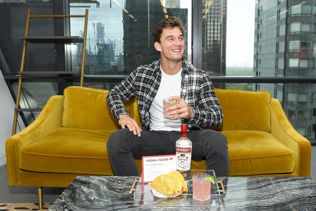 Tyler Cameron on sofa in New York City.