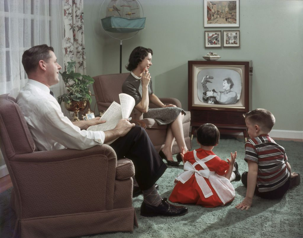 A 1950s family watching tv