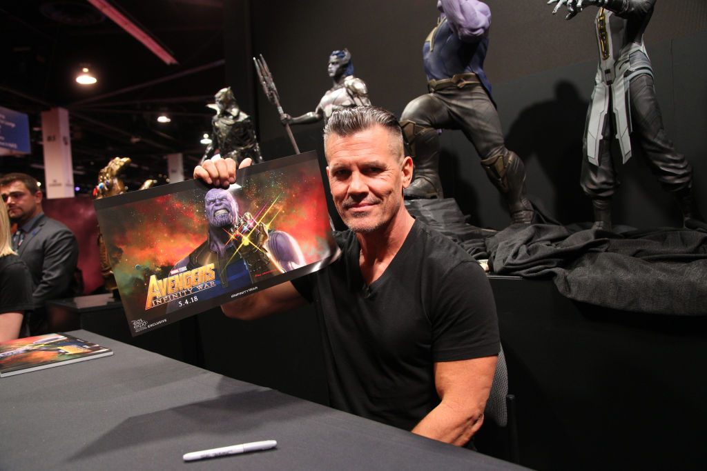 Actor Josh Brolin holds a promo picture of his character Thanos from the Avengers Infinity War movie