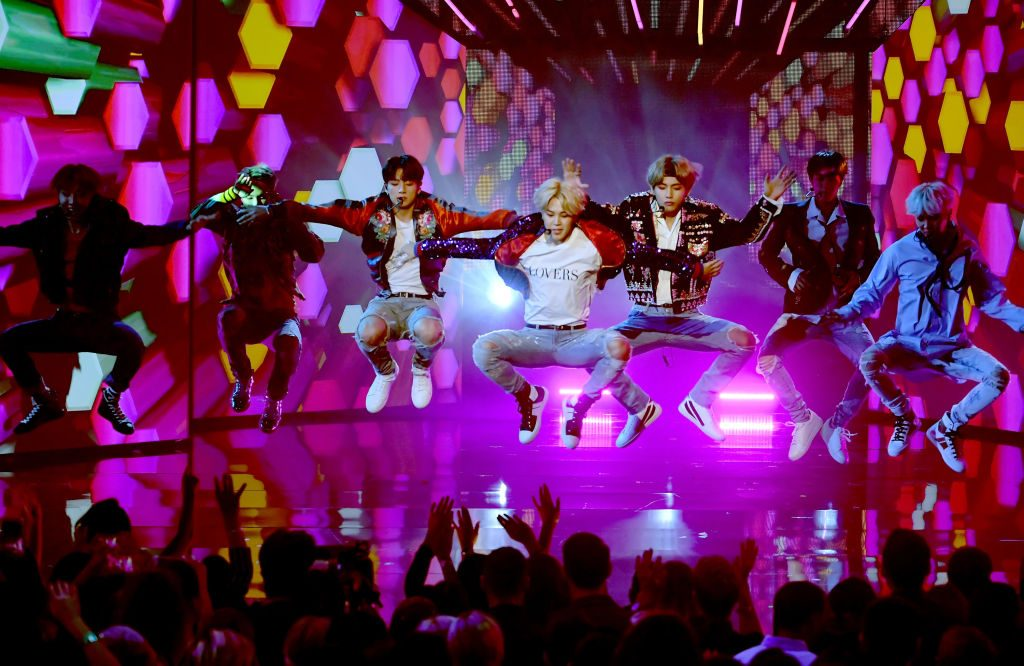 Music group BTS performs onstage during the 2017 American Music Awards