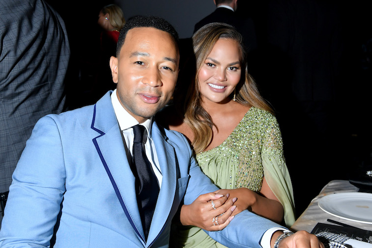 John Legend and Chrissy Teigen at a formal gala